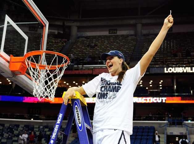 Stefanie Dolson #31 of the Connecticut Huskies cuts down the net after