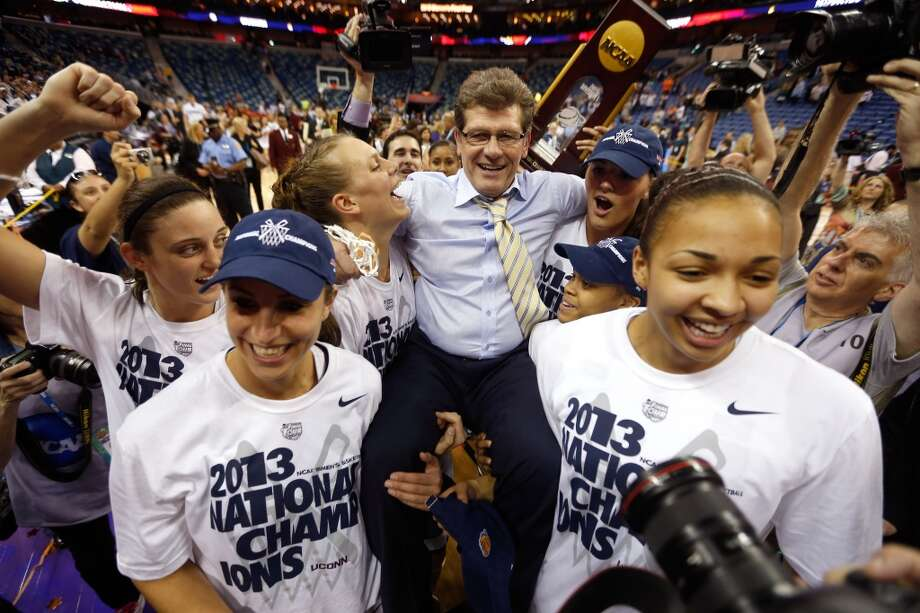 Head coach Geno Auriemma of the Connecticut Huskies is carried off the court by his players after defeating the Louisville Cardinals winning his eighth National Championship during the 2013 NCAA Women\'s Final Four Championship at New Orleans Arena on April 9, 2013 in New Orleans, Louisiana.