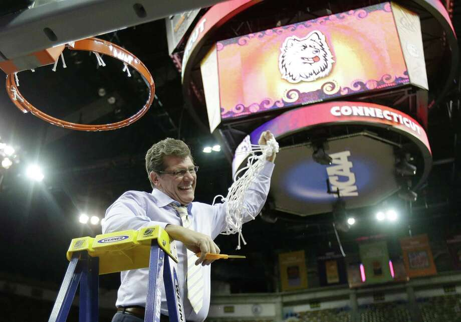 Connecticut head coach Geno Auriemma reacts after cutting the net down with Connecticut players celebrating after defeating Louisville 93-60 in the national championship game of the women's Final Four of the NCAA college basketball tournament, Tuesday, April 9, 2013, in New Orleans. (AP Photo/Gerald Herbert) Photo: Gerald Herbert, Associated Press / AP