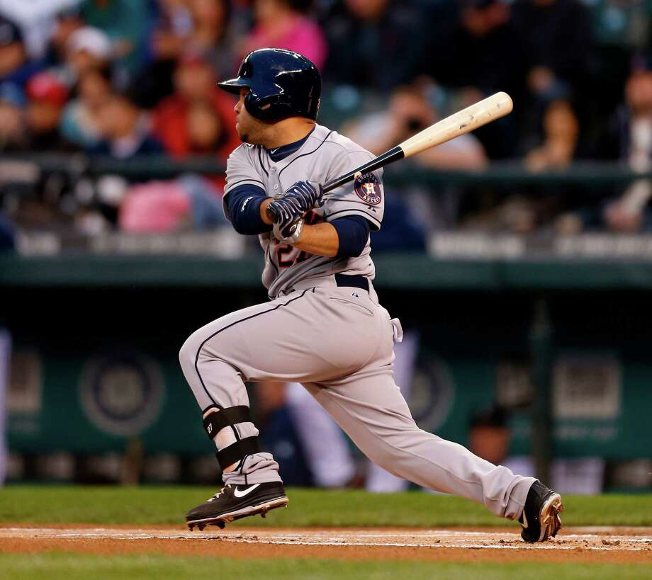Jose Altuve collected four hits, including two in the first inning, and had a career-high four RBIs as the Astros burst out of their offensive slump Tuesday night. Photo: Otto Greule Jr, Stringer / 2013 Getty Images