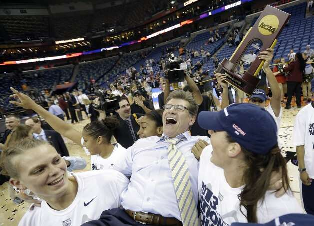 Connecticut players celebrate as they carry head coach Geno Auriemma off the court after defeating Louisville 93-60 in the national championship game of the women\'s Final Four of the NCAA college basketball tournament, Tuesday, April 9, 2013, in New Orleans.