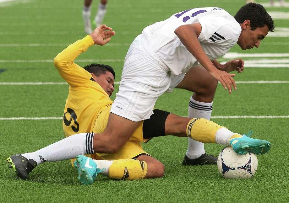 Lee's Selvin Guzman (9) tackles Ridge Point defender Zachary Evans. Photo: J. Patric Schneider, Freelance / © 2013 Houston Chronicle