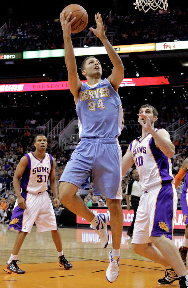 Denver Nuggets guard Evan Fournier (94) shoots over Phoenix Suns power forward Luke Zeller (40) during the first half of a preseason NBA basketball game, Friday, Oct. 26, 2012, in Phoenix. Photo: Matt York, ASSOCIATED PRESS / AP2012