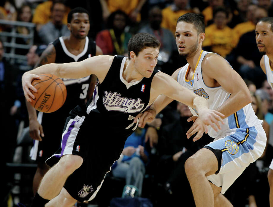Sacramento Kings guard Jimmer Fredette, left, works the ball inside past Denver Nuggets guard Evan Fournier, of France, in the fourth quarter of the Nuggets\' 121-93 victory in an NBA basketball game in Denver on Saturday, Jan. 26, 2013. Photo: David Zalubowski, ASSOCIATED PRESS / AP2013