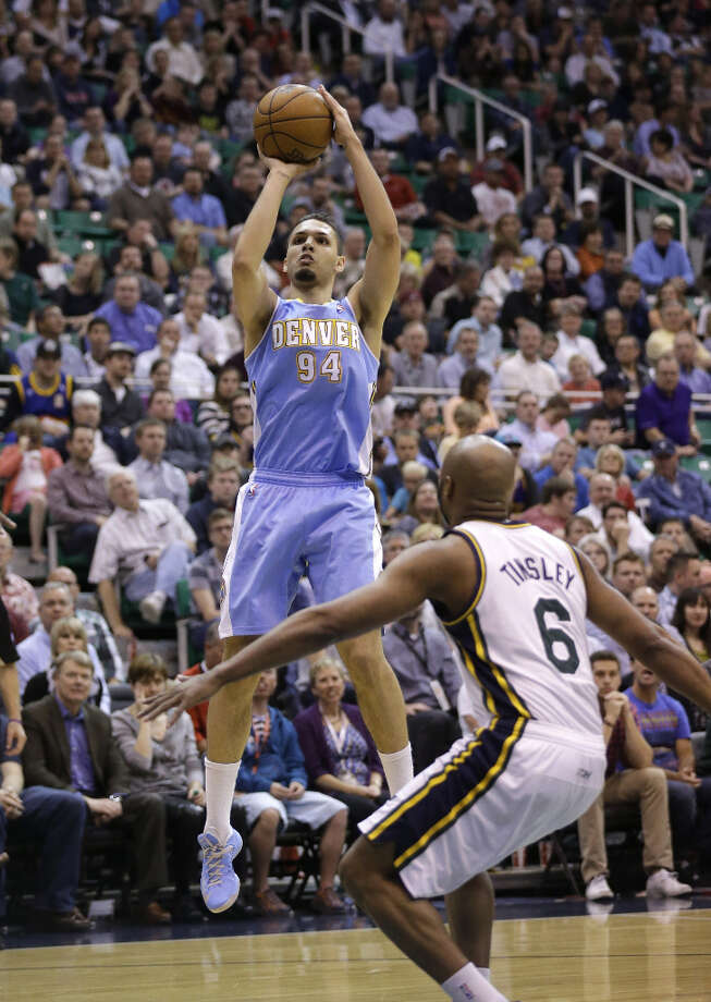 Denver Nuggets\' Evan Fournier (94) shoots as Utah Jazz\'s Jamaal Tinsley (6) looks on in the second quarter during an NBA basketball game on Wednesday, April 3, 2013, in Salt Lake City. Photo: Rick Bowmer, Associated Press / AP