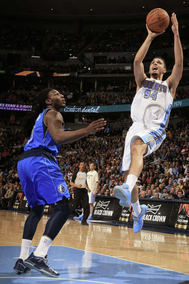 Denver Nuggets\' Evan Fournier (94) takes a shot against Dallas Mavericks\' Jae Crowder (9) at the Pepsi Center on Thursday, April 4, 2013, in Denver. The Nuggets defeated the Mavericks 95-94. Photo: Doug Pensinger, Getty Images / 2013 Getty Images