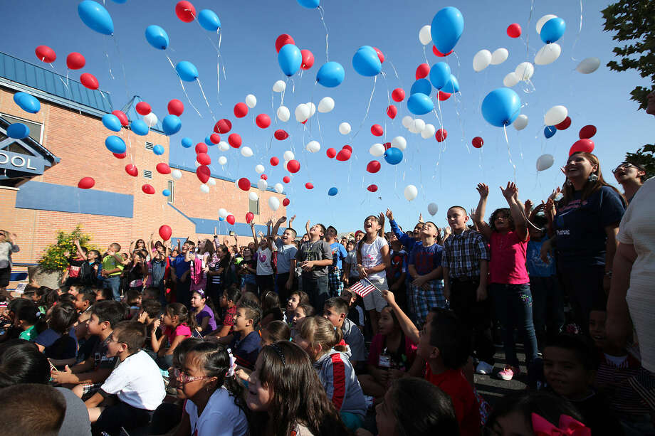 This was the scene at Armstrong Elementary School after its namesake, astronaut Neil Armstrong, died in 2012. Some people claim the balloons degrade at the same rate as an oak leaf, but others say they wind up in the ocean. Photo: San Antonio Express-News / File Photo