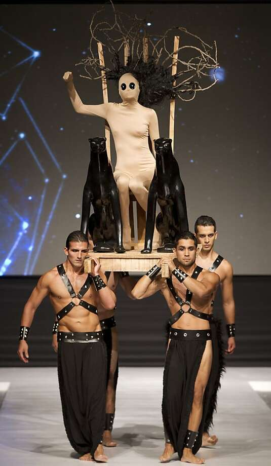 Models present creations from Peru's designer Elfer Castro during the third edition of Lima Fashion Week in Lima, Peru, Monday, April 8, 2013. Lima Fashion Week shows off Peruvian designers' creations through Saturday. (AP Photo/Martin Mejia) Photo: Martin Mejia, Associated Press