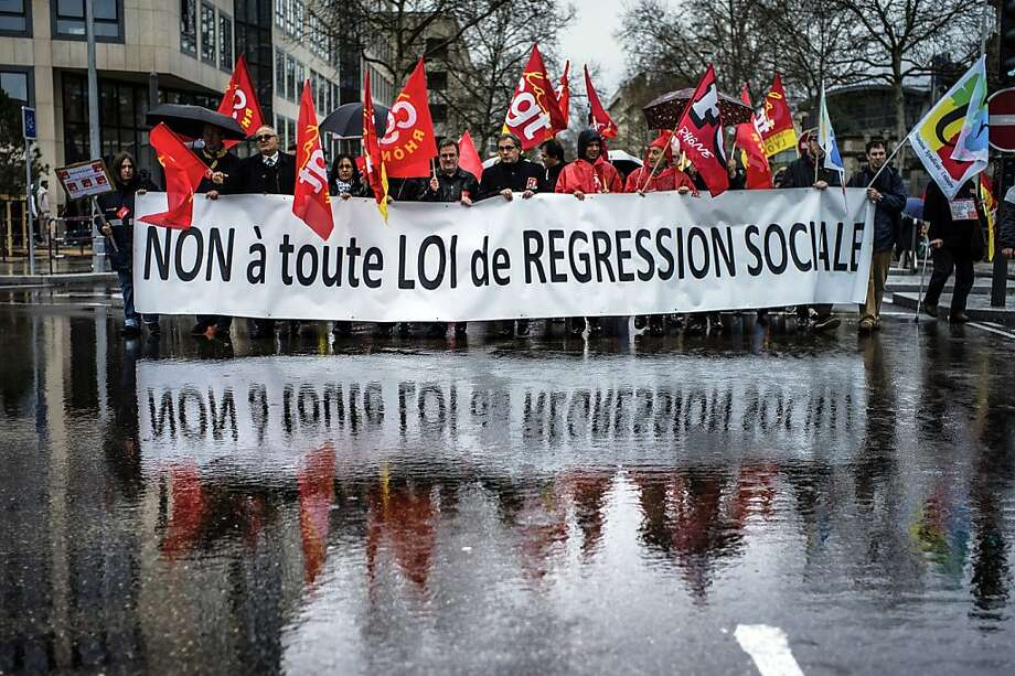 "TOPSHOTS  People take part in a demonstration against a bill to reform the country's labour laws based on an agreement reached between employers and unions, on April 9, 2013 in Lyon. The bill is designed to give more flexibility to employers but also to offer more protection to employees, a key concern of French unions. Banner reads ""no to all laws of social regression"".    AFP PHOTO / JEFF PACHOUDJEFF PACHOUD/AFP/Getty Images Photo: Jeff Pachoud, AFP/Getty Images"