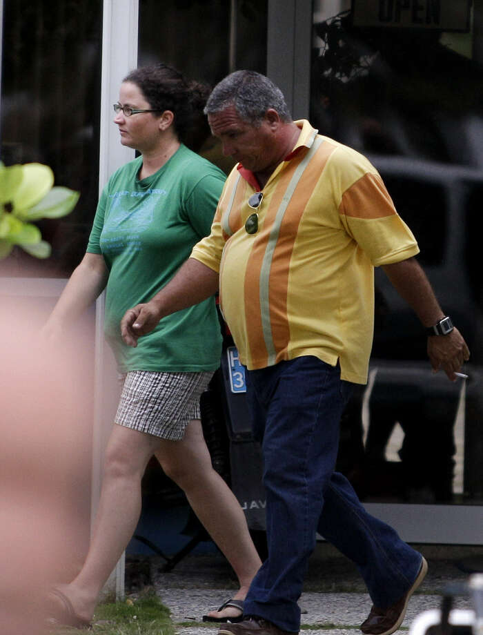 Sharyn Hakken is escorted by a state security officer at the Hemingway Marina in Havana on Tuesday. Photo: Franklin Reyes / Associated Press