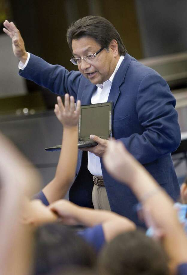 One concern for the SAISD board is what would happen if the Internal Revenue Service demands the full amount and Manuel Isquierdo — seen here interacting with fifth-graders at the Sunnyside Unified School District in Tucson, Ariz. — can't pay. Photo: Ron Medvescek /