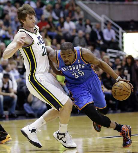 Oklahoma City's Kevin Durant drives around Utah guard Gordon Hayward in the first quarter at EnergySolutions Arena in the Thunder's 90-80 win. Photo: Rick Bowmer / Associated Press