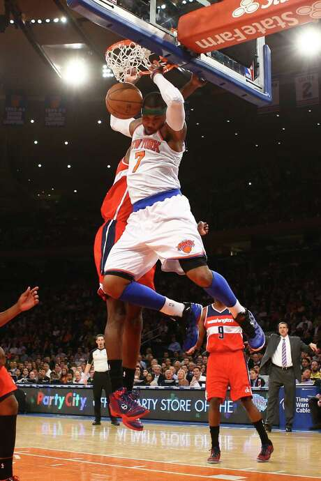 Carmelo Anthony dunks for two of his 36 points in the Knicks' victory over the Wizards. Photo: Al Bello / Getty Images