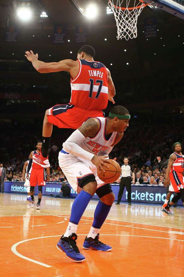 The Knicks' Carmelo Anthony, who scored 36 points, gets the Wizards' Garrett Temple to bite on a fake. Photo: Al Bello, Staff / 2013 Getty Images