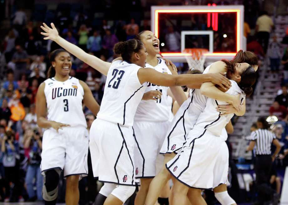 Kaleena Mosqueda-Lewis (23) joins her Connecticut teammates to celebrate the school's eighth national championship, matching Tennessee for the all-time high. Photo: Chris Graythen, Staff / 2013 Getty Images