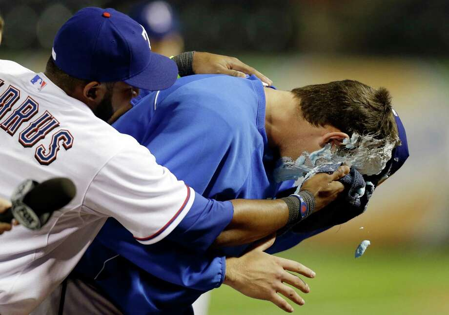 Rangers rookie Nick Tepesch gets the shaving cream pie treatment from Elvis Andrus after beating the Rays. Photo: Tony Gutierrez, STF / AP