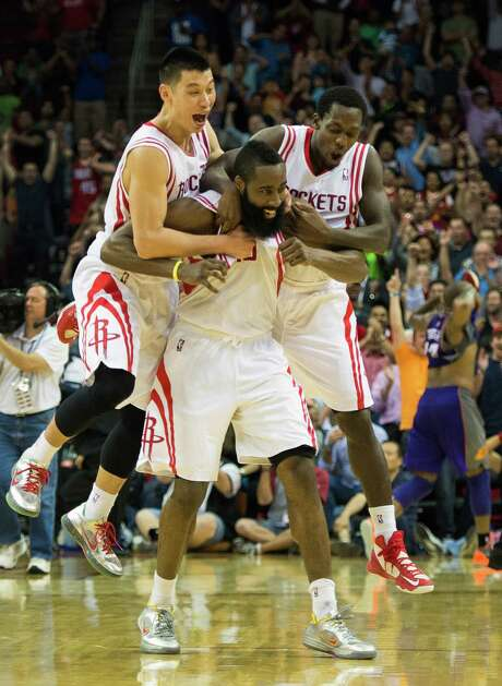 To the delight of Jeremy Lin, left, and Patrick Beverley, right, James Harden found a new way to win a game for the Rockets with a 3-pointer at the buzzer that was ruled good via goaltending. Photo: Smiley N. Pool, Staff / © 2013  Houston Chronicle
