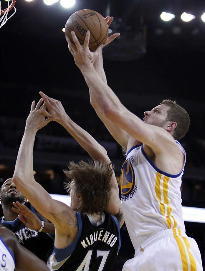 David Lee (10) pulls in a rebound over Andrei Kirilenko (47) in the first half. The Golden State Warriors played the Minnesota Timberwolves at Oracle Arena in Oakland, Calif., on Tuesday, April 9, 2013. Photo: Carlos Avila Gonzalez, The Chronicle