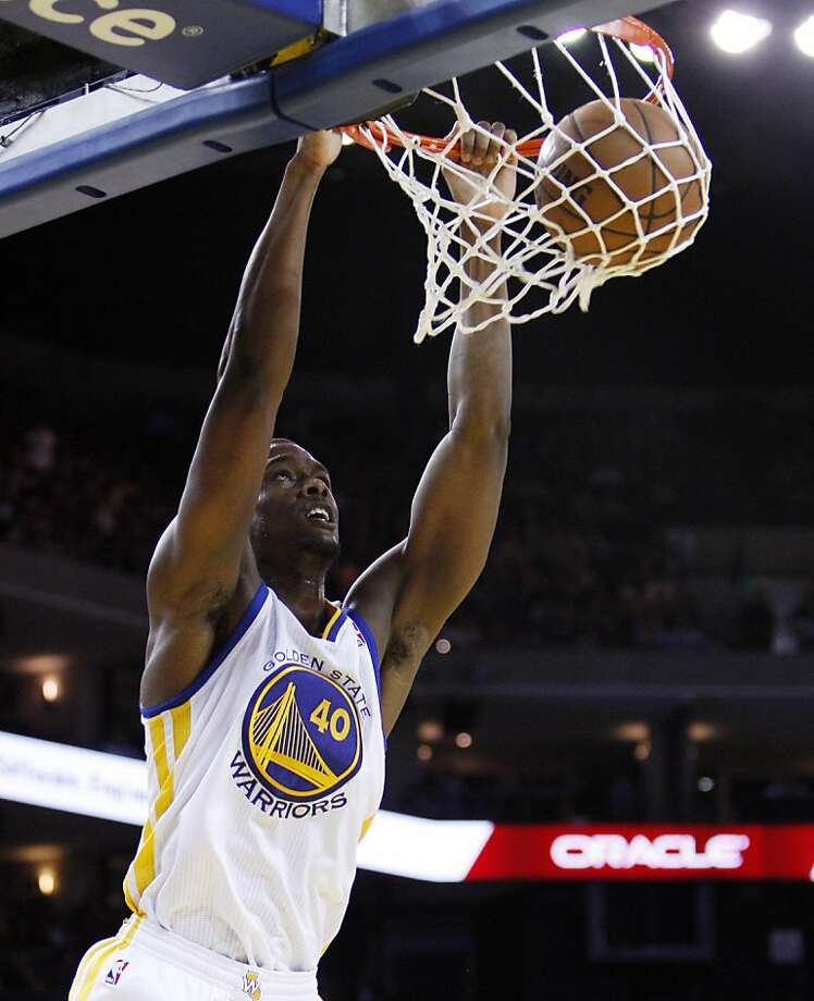 Harrison Barnes (40) dunks the ball in the first half. The Golden State Warriors played the Minnesota Timberwolves at Oracle Arena in Oakland, Calif., on Tuesday, April 9, 2013. Photo: Carlos Avila Gonzalez, The Chronicle