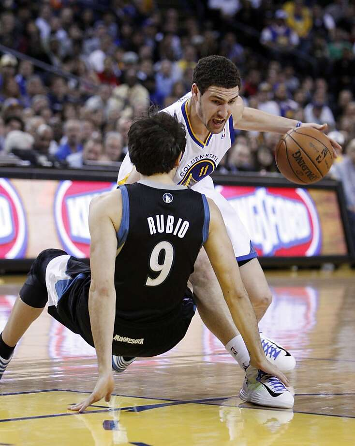 Klay Thompson (11) crosses up Ricky Rubio (9) in the first half. The Golden State Warriors played the Minnesota Timberwolves at Oracle Arena in Oakland, Calif., on Tuesday, April 9, 2013. Photo: Carlos Avila Gonzalez, The Chronicle
