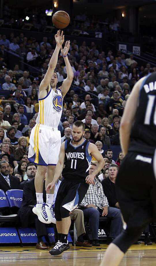Klay Thompson (11) puts up a three point shot over J.J. Barea (11) in the first half. The Golden State Warriors played the Minnesota Timberwolves at Oracle Arena in Oakland, Calif., on Tuesday, April 9, 2013. Photo: Carlos Avila Gonzalez, The Chronicle