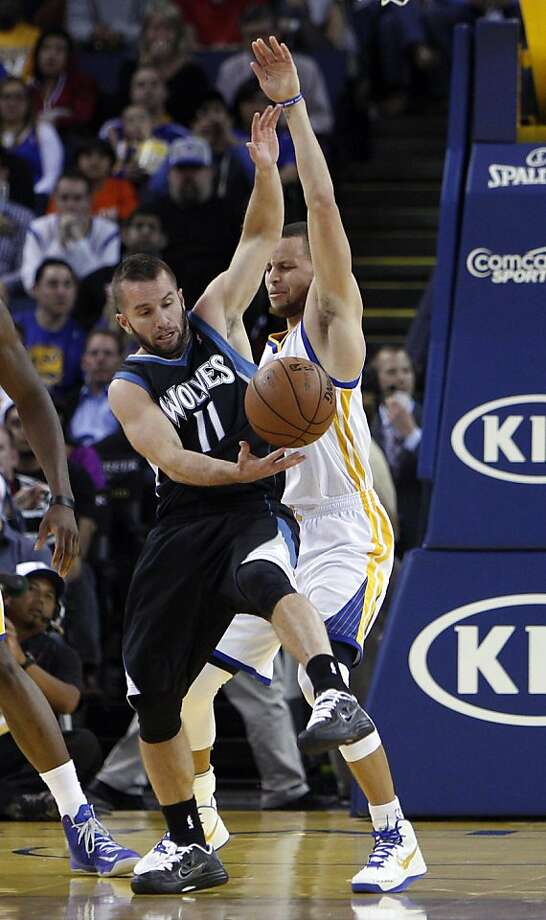 Stephen Curry (30) is called for a foul after getting tangled up with J.J. Barea (11) in the first half. The Golden State Warriors played the Minnesota Timberwolves at Oracle Arena in Oakland, Calif., on Tuesday, April 9, 2013. Photo: Carlos Avila Gonzalez, The Chronicle