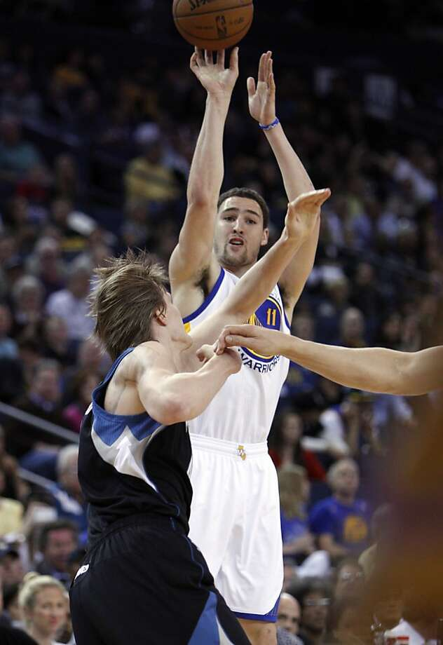 Klay Thompson (11) puts up a shot over Andrei Kirilenko (47) in the first half. The Golden State Warriors played the Minnesota Timberwolves at Oracle Arena in Oakland, Calif., on Tuesday, April 9, 2013. Photo: Carlos Avila Gonzalez, The Chronicle