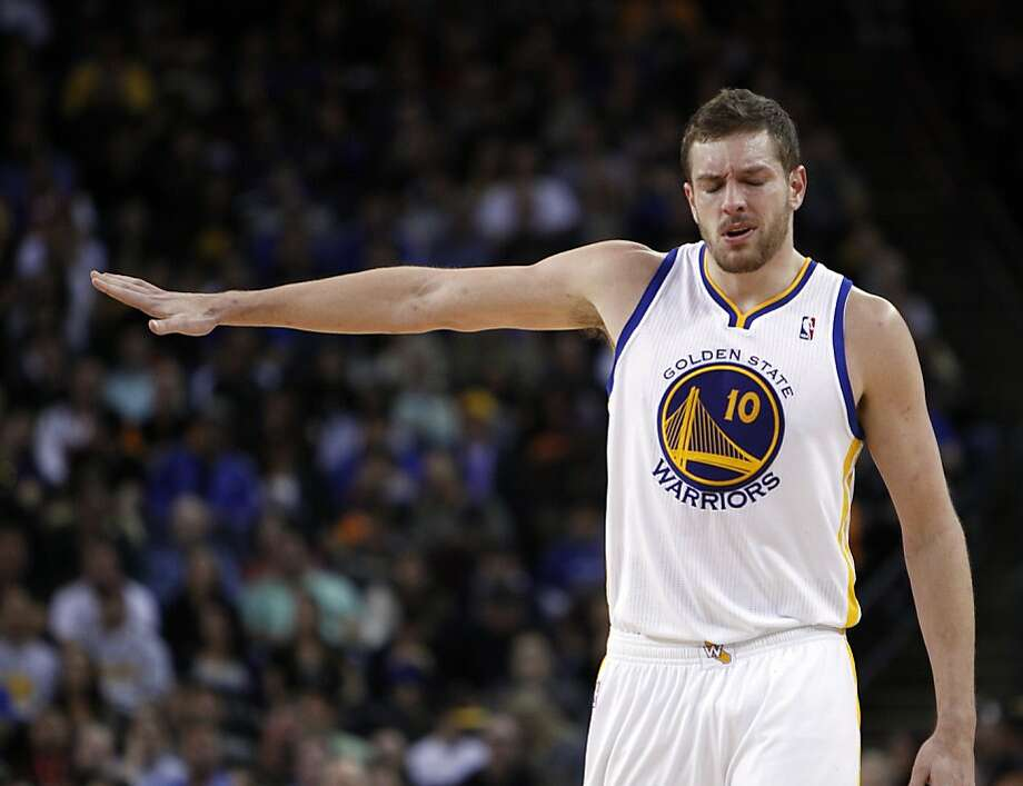 David Lee (10) tells the bench he's okay after getting hit in the face on a rebound attempt in the first half. The Golden State Warriors played the Minnesota Timberwolves at Oracle Arena in Oakland, Calif., on Tuesday, April 9, 2013. Photo: Carlos Avila Gonzalez, The Chronicle