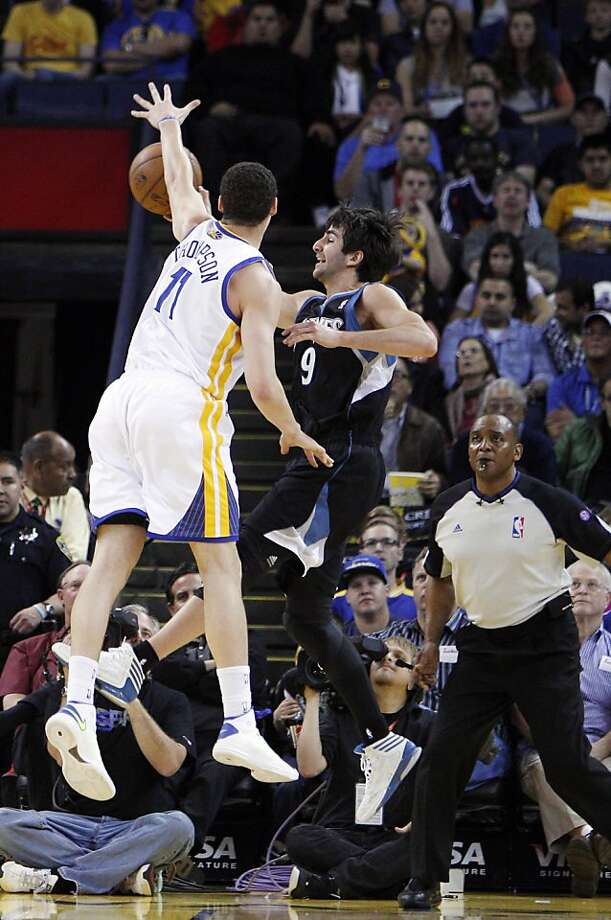 Klay Thompson (11) tries to defend against Ricky Rubio (9) in the first half. The Golden State Warriors played the Minnesota Timberwolves at Oracle Arena in Oakland, Calif., on Tuesday, April 9, 2013. Photo: Carlos Avila Gonzalez, The Chronicle