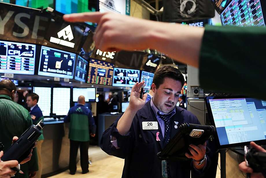 NEW YORK, NY - APRIL 09: Traders work on the floor of the New York Stock Exchange on April 9, 2013 in New York City. The Dow Jones Industrial Average hit a new record trading high of 14,706 today, while closing slightly lower at 14,673.46.  (Photo by Spencer Platt/Getty Images)  *** BESTPIX *** Photo: Spencer Platt, Getty Images