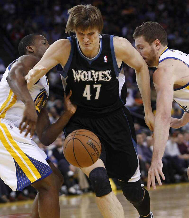Minnesota Timberwolves' Andrei Kirilenko (47) loses control of the ball between Golden State Warriors' Harrison Barnes, left and David Lee during the first half of an NBA basketball game, Tuesday, April 9, 2013, in Oakland, Calif. (AP Photo/George Nikitin) Photo: George Nikitin, Associated Press