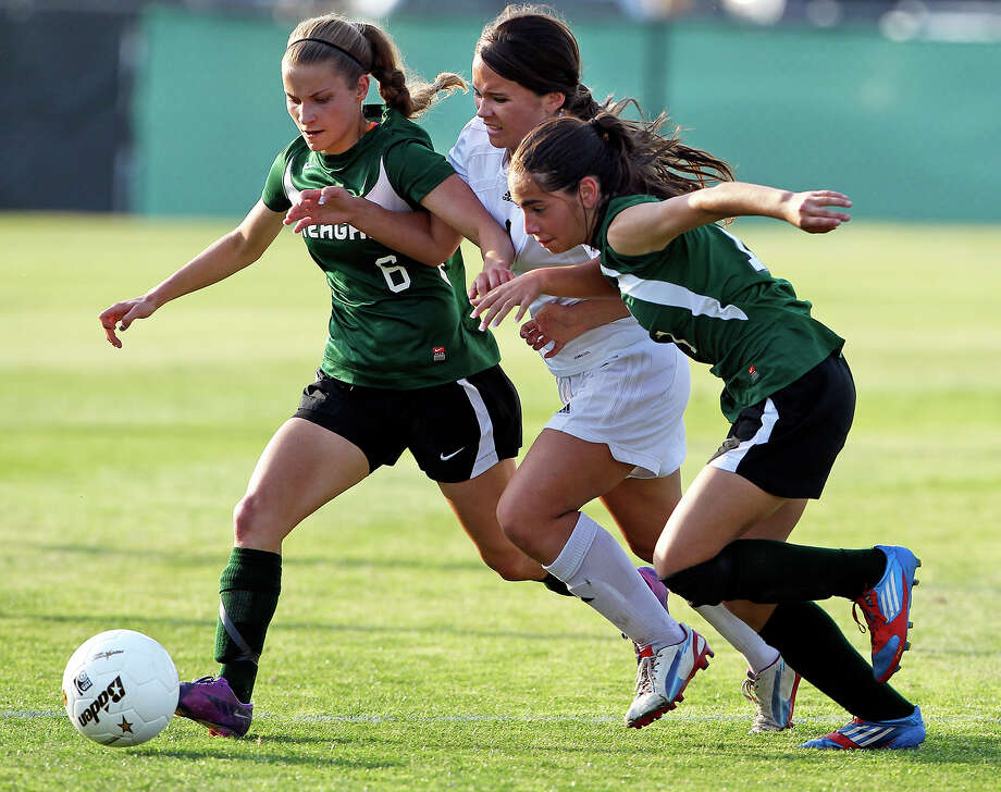 Reagan girls Nicki Martindale (6) and Gabriela Galan pinch out Churchill's Scout Reid  in soccer playoffs at Blossom Athletic Center  on  April 9, 2013. Photo: Tom Reel, San Antonio Express-News