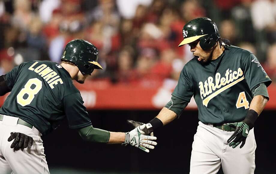 Oakland Athletics' Coco Crisp celebrates his home run with Jed Lowrie during the second inning of a baseball game against the Los Angeles Angels in Anaheim, Calif. Tuesday, April 9, 2013. (AP Photo/Chris Carlson) Photo: Chris Carlson, Associated Press