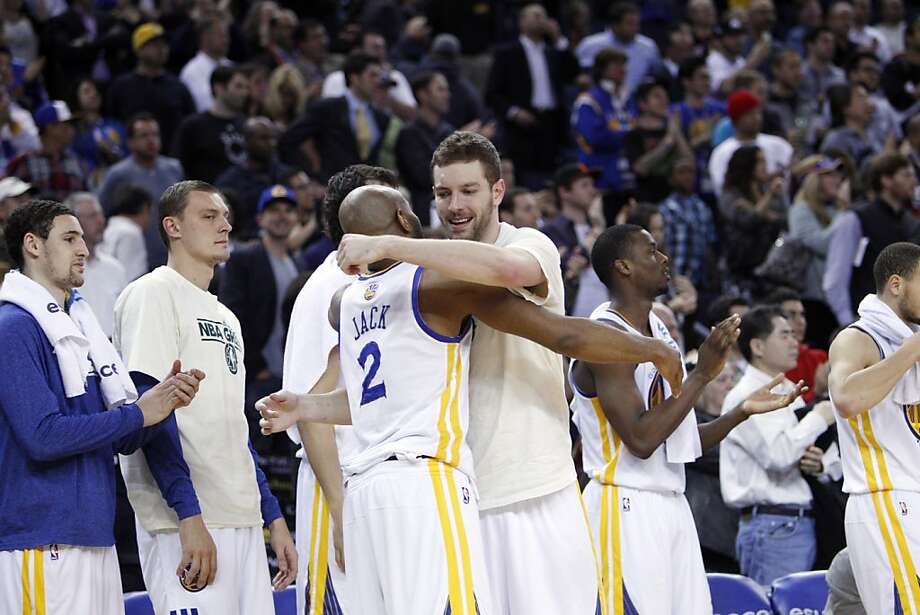 David Lee, right, and Jarrett Jack, left, hug after the Warriors defeated the Timberwolves to clinch a playoff berth on Tuesday. The Golden State Warriors played the Minnesota Timberwolves at Oracle Arena in Oakland, Calif., on Tuesday, April 9, 2013, winning the game 105-89 and clinching a playoff berth for the first time since 2007. Photo: Carlos Avila Gonzalez, The Chronicle