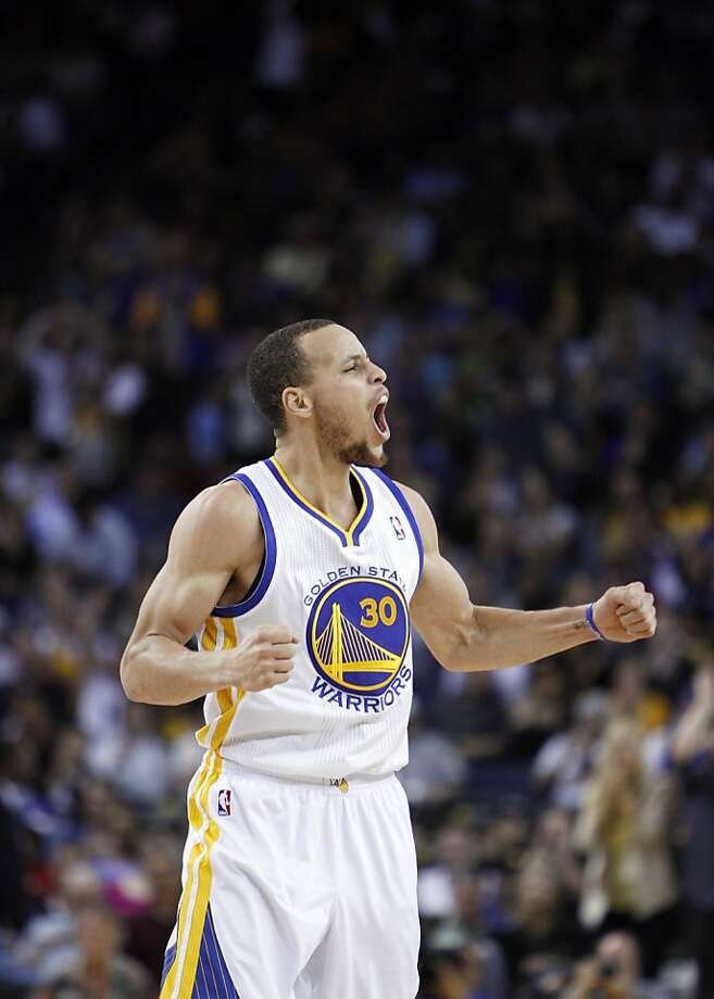 Stephen Curry reacts after hitting a three-point shot in the second half. The Golden State Warriors played the Minnesota Timberwolves at Oracle Arena in Oakland, Calif., on Tuesday, April 9, 2013, winning the game 105-89 and clinching a playoff berth for the first time since 2007. Photo: Carlos Avila Gonzalez, The Chronicle