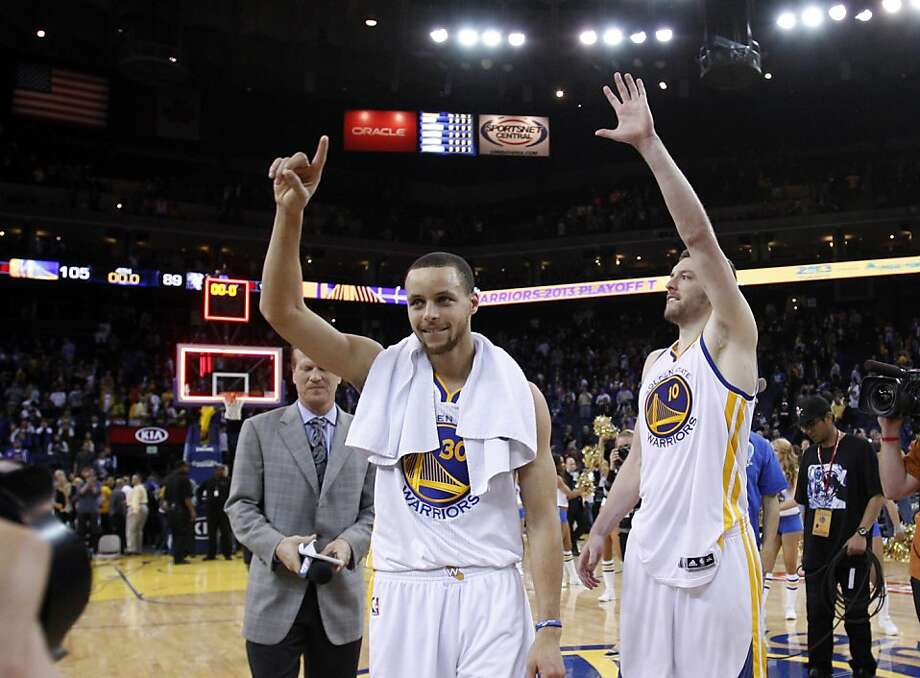 Stephen Curry, left, and David Lee, right, celebrate as they walk off the court after the Warriors defeated the Timberwolves to clinch a playoff berth, Tuesday. The Golden State Warriors played the Minnesota Timberwolves at Oracle Arena in Oakland, Calif., on Tuesday, April 9, 2013, winning the game 105-89 and clinching a playoff berth for the first time since 2007. Photo: Carlos Avila Gonzalez, The Chronicle