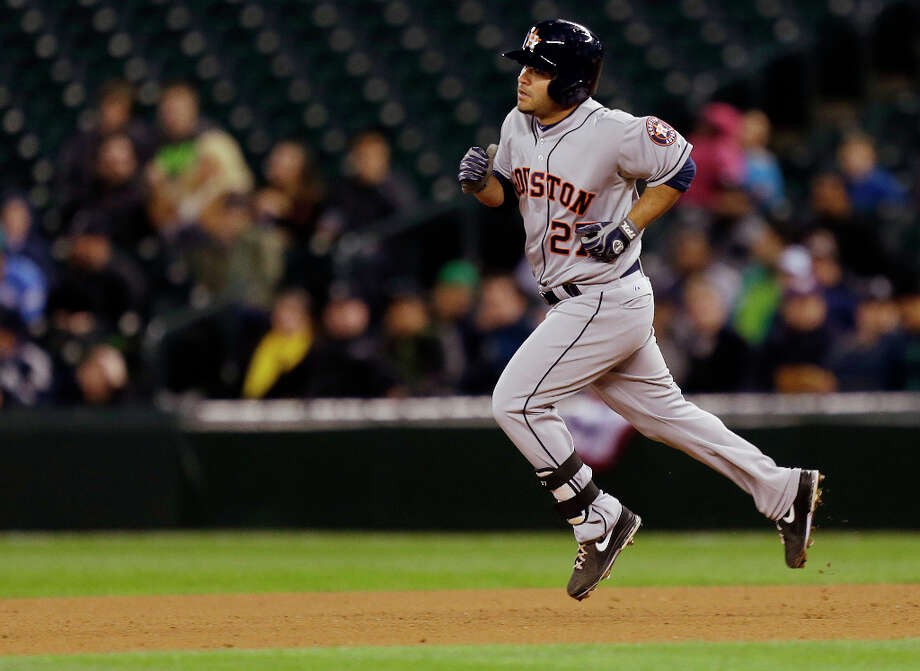 April 9: Astros 16, Mariners 9 Jose Altuve trots around the bases after his two-run home run. Photo: Ted S. Warren, Associated Press