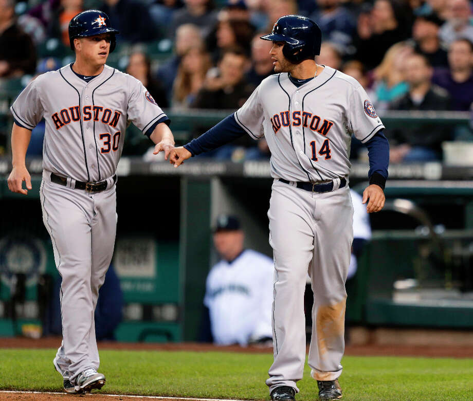 J.D. Martinez (14) and Matt Dominguez (30) bump fists after they scored in the first inning. Photo: Ted S. Warren, Associated Press