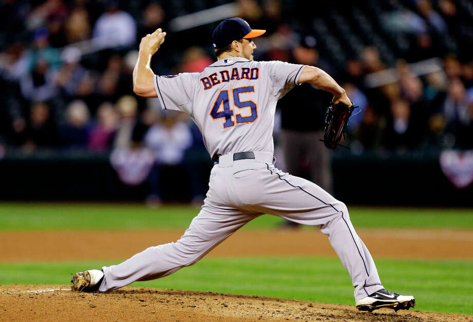 Astros starting pitcher Erik Bedard throws against the Mariners in the third inning. Photo: Ted S. Warren, Associated Press / AP