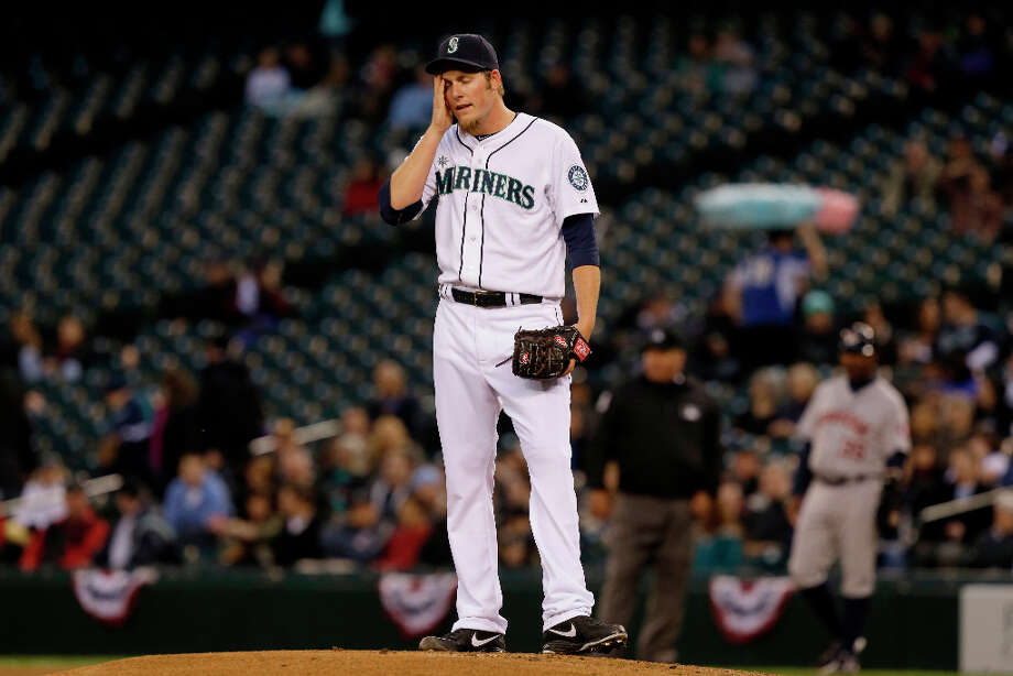 Mariners starting pitcher Brandon Maurer reacts on the mound after Carlos Pena hit a two run double in the first inning. Photo: Ted S. Warren, Associated Press