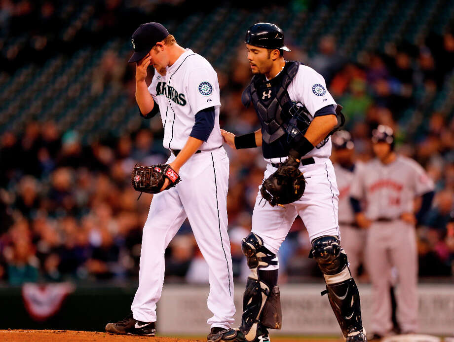 Starting pitcher Brandon Maurer #37 of the Mariners gets a visit from catcher Jesus Montero #63 in the first inning. Photo: Otto Greule Jr, Getty Images / 2013 Getty Images