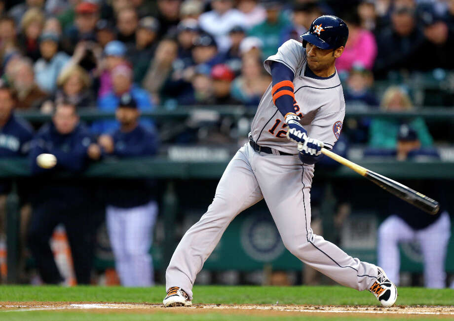 Carlos Pena hits a two-run double in the first inning. Photo: Ted S. Warren, Associated Press