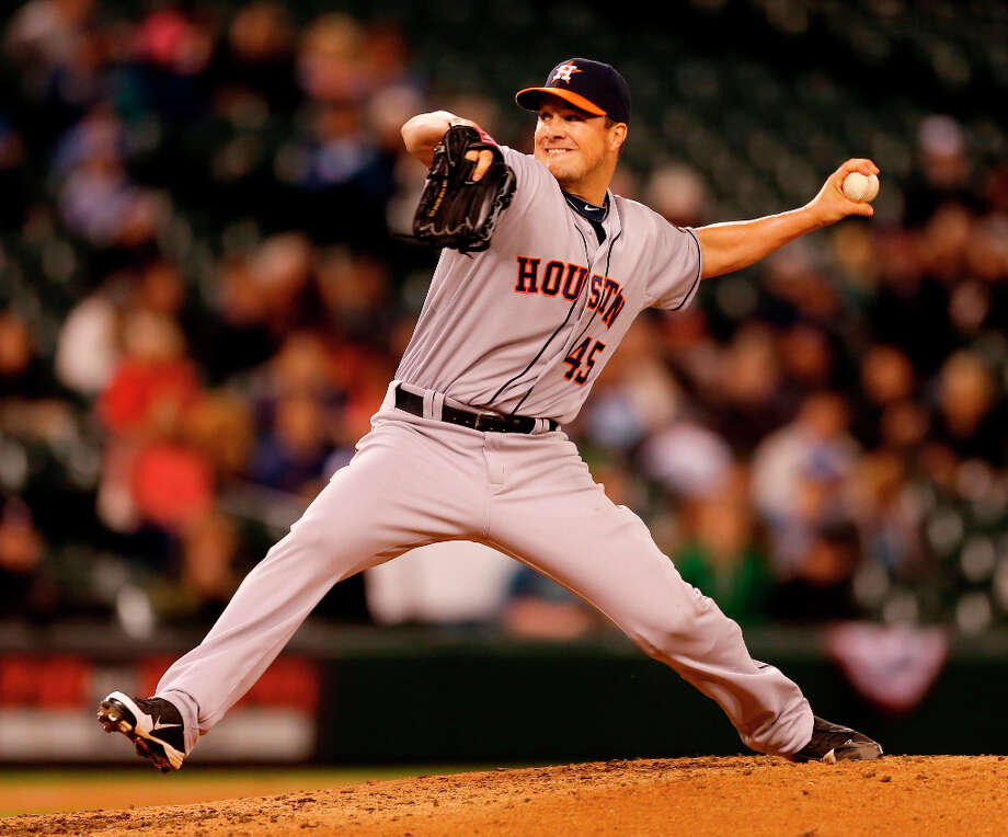 Starting pitcher Erik Bedard #45 of the Astros pitches in the fourth inning. Photo: Otto Greule Jr, Getty Images / 2013 Getty Images
