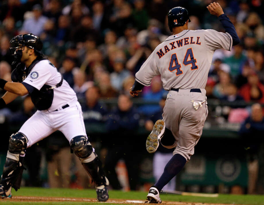 Justin Maxwell scores one of six runs scored in the first inning. Photo: Ted S. Warren, Associated Press