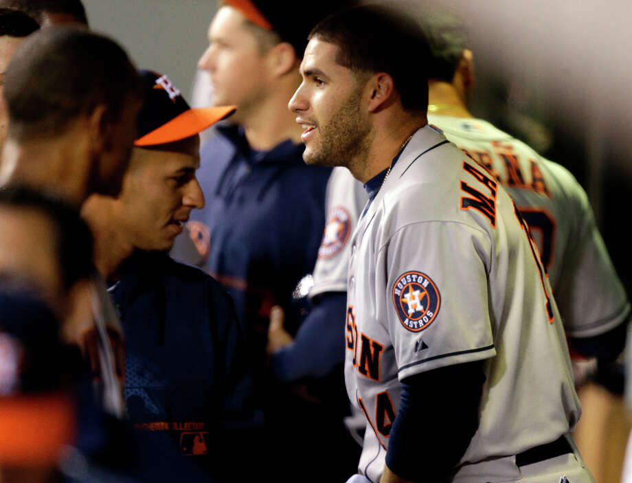 J.D. Martinez reacts in the dugout after he hit a home run in the second inning. Photo: Ted S. Warren, Associated Press