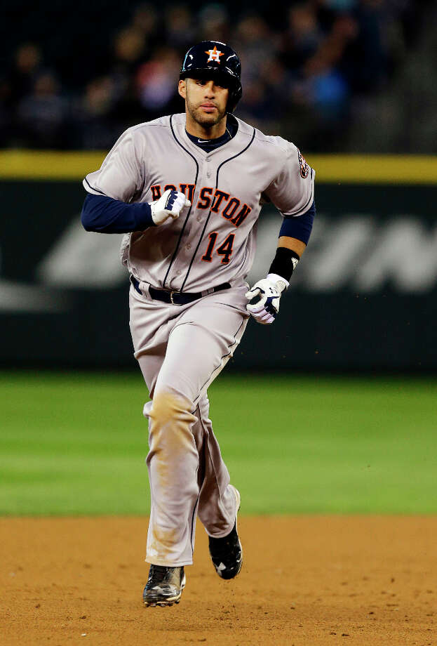 J.D. Martinez runs the bases after hitting a two-run home run. Photo: Ted S. Warren, Associated Press / AP