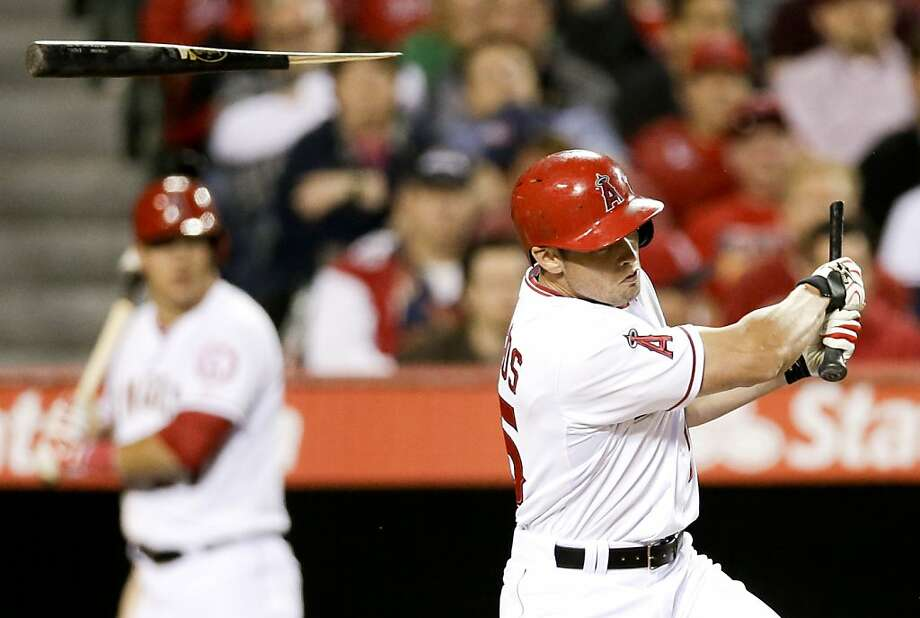 Los Angeles Angels' Mike Trout hits a single and breaks his batt during the fourth inning of a baseball game against the Oakland Athletics in Anaheim, Calif. Tuesday, April 9, 2013. (AP Photo/Chris Carlson) Photo: Chris Carlson, Associated Press