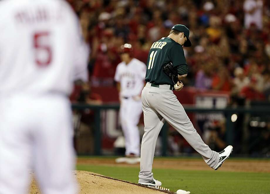 Oakland Athletics starting pitcher Jarrod Parker kicks the mound after loading the bases during the first inning of a baseball game against the Los Angeles Angels in Anaheim, Calif., Tuesday, April 9, 2013. (AP Photo/Chris Carlson) Photo: Chris Carlson, Associated Press