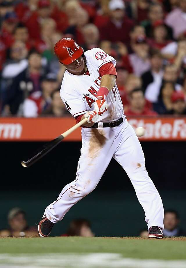 ANAHEIM, CA - APRIL 09:  Mike Trout #27 of the Los Angeles Angels of Anaheim hits a base hit in the fourth inning against the Oakland Athletics during the home opener at Angel Stadium of Anaheim on April 9, 2013 in Anaheim, California.  (Photo by Jeff Gross/Getty Images) Photo: Jeff Gross, Getty Images