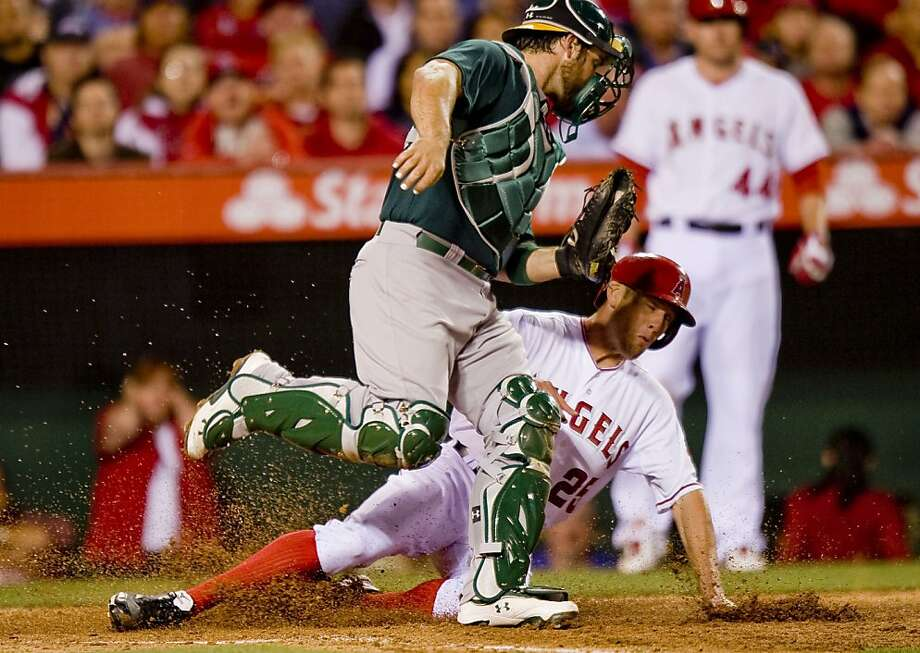 The Los Angeles Angels' Peter Bourjos is forced at home plate by Oakland Athletics catcher Derek Norris in the fourth inning at Angel Stadium in Anaheim, California, on Tuesday, April 9, 2013. (Paul Rodriguez/Orange County Register/MCT) Photo: Paul Rodriguez, McClatchy-Tribune News Service